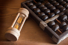 Hourglass with abacus Stock Photos