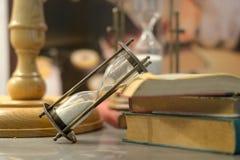 Hourglass add  book Stock Image