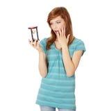 Hourglass adolescente da terra arrendada da mulher imagens de stock royalty free