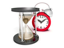 Hourglass and alarm ckock on white background Stock Photography