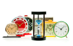Hourglass and alarm clocks Royalty Free Stock Photo