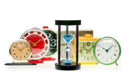 Hourglass and alarm clocks Royalty Free Stock Photo