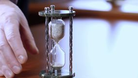 Hourglass as time passing concept for business deadline, urgency and running out of time. stock video