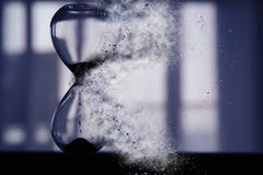 Hourglass as time passing and pass away concept. Hourglass as time passing and pass away concept stock image