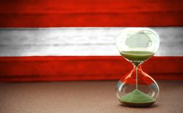 Hourglass on the background of the Austria flag, the concept of time and countries, space for text stock photography