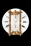 Hourglass on background clock dial Royalty Free Stock Images