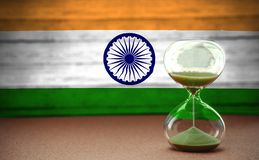 Hourglass on the background of the Indian flag, the concept of time and countries, space for text royalty free stock photos