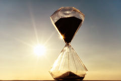 Hourglass on a background sunset Royalty Free Stock Photos