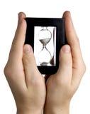Hourglass on beach Stock Image
