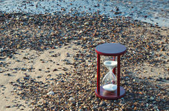 Hourglass on the beach Royalty Free Stock Image
