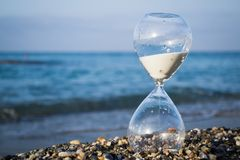Hourglass on the beach. On the Mediterranean coast, Turkey. Time stock photography