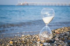 Hourglass on the beach. On the Mediterranean coast, Turkey. Time stock photo