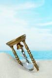 Hourglass on the beach Stock Photo