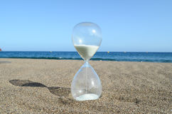 Hourglass on a Beach Stock Photos