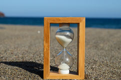 Hourglass on a Beach Royalty Free Stock Images