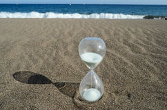 Hourglass on a Beach Stock Image