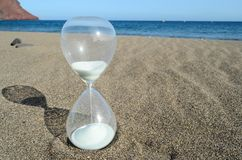 Hourglass on a Beach Stock Photography