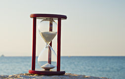 Hourglass on the beach of the Red Sea Stock Image