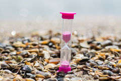 Hourglass on the beach Royalty Free Stock Photos