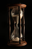Hourglass on black background Stock Images