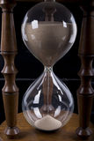 Hourglass on black background. Wooden glass hourglass on black background Royalty Free Stock Images