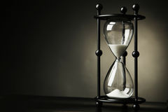 Hourglass. Black hourglass on black background Stock Images