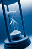 Hourglass in blue Stock Photos