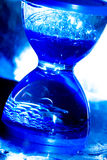 Hourglass in blue color Stock Photos
