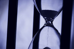 Hourglass in blue light. Hourglass in blue light closeup. For illustrations of passing time Royalty Free Stock Image