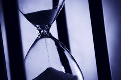 Hourglass in blue light. Royalty Free Stock Photography