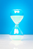 Hourglass with blue sand Royalty Free Stock Photography