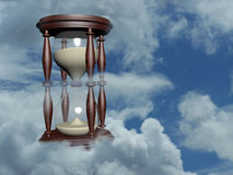 Hourglass in the blue sky. 3d illustration over sky photo Stock Images