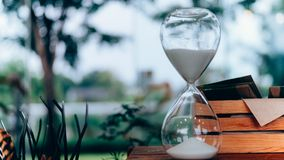 An hourglass with blurred background stock photos