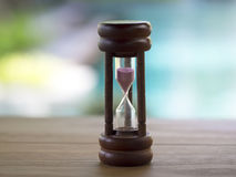 Hourglass on blurred natural background Royalty Free Stock Images