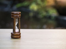 Hourglass on blurred natural background, select focus Royalty Free Stock Images