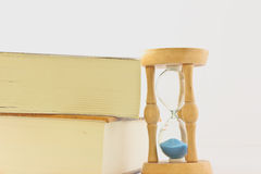Hourglass with book Stock Photography