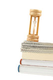 Hourglass and books Royalty Free Stock Photo
