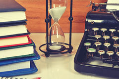 Hourglass, books and typewriter Stock Photography