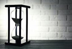 Hourglass on brick. Wall background Royalty Free Stock Photography