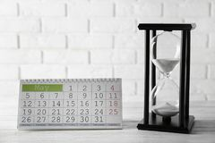 Hourglass with calender royalty free stock photos