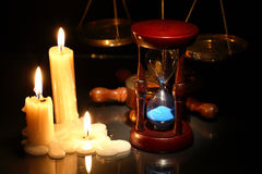 Hourglass And Candles Royalty Free Stock Image