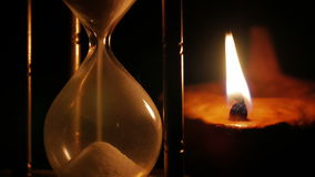 Hourglass and clay oil lamp stock footage