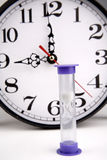 Hourglass and clock Royalty Free Stock Image