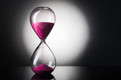 Hourglass clock. On black background Stock Images