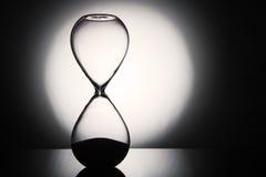 Hourglass clock. On dark background stock image
