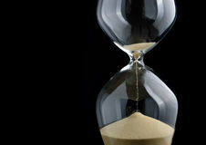 Hourglass. Close-up hourglass on black background Stock Photography