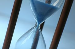 Hourglass on color background, closeup. Time management concept stock photos