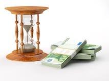 Hourglass com euro Imagens de Stock
