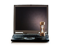 Hourglass computer Stock Photography