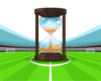 Hourglass countdown in the midfield of football stadium vector Royalty Free Stock Photo